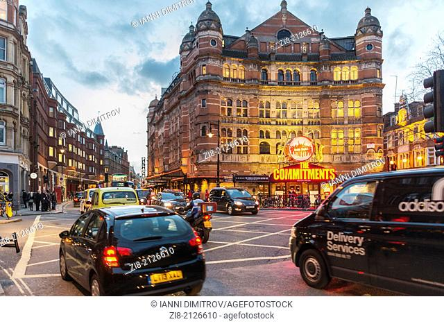 Evening traffic on Shaftesbury Avenue with The Palace Theatre ,London,England