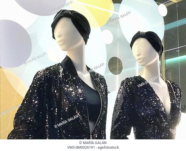 Two mannequins in a shop window. Serrano street, Madrid, Spain