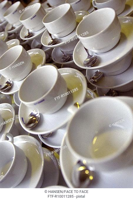 White cups with spoons
