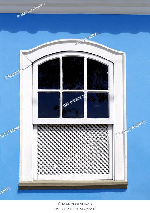 a white window closed of a house at bahia