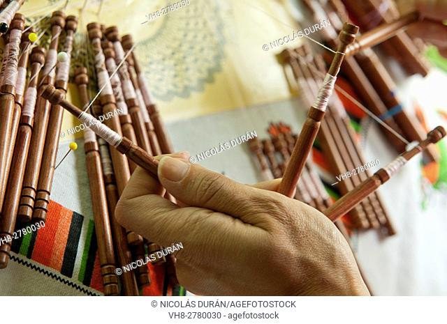 Woman kniting bolillos. Spain