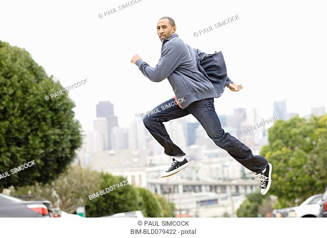 African American man running on urban street