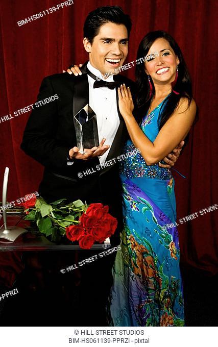 Celebrity couple accepting an award