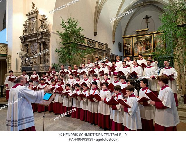 The Vatican-based Sistine Chapel Choir led by its director Massimo Palombella (front L)performs during a rehearsal prior to an ecumenical concert held at the...