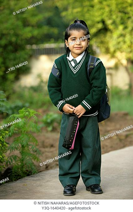 Young girl ready for school in India