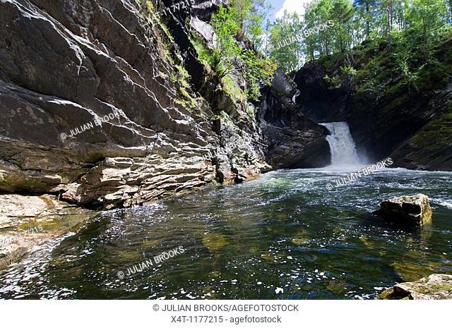 Waterfall in Hornindal, Norway, summer sunshine