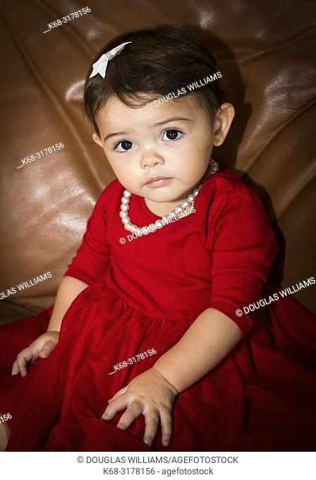girl, 1 1/2 year old in red dress with pearl necklace