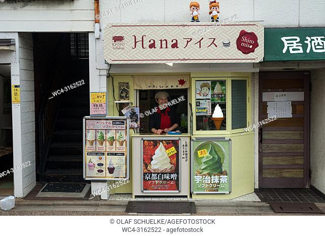 24. 12. 2017, Kyoto, Japan, Asia - A woman sells soft ice cream at a kiosk in Kyoto
