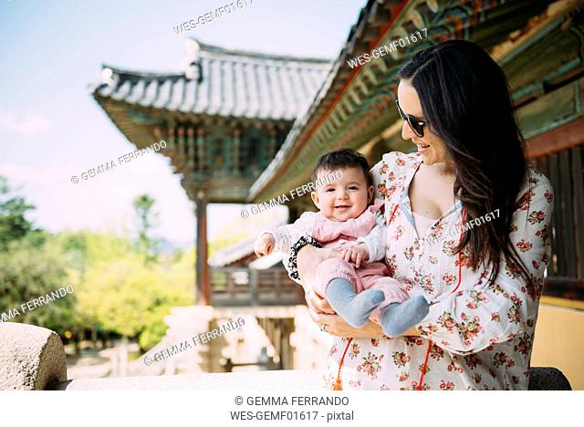 South Korea, Gyeongju, woman traveling with a baby girl in Bulguksa Temple