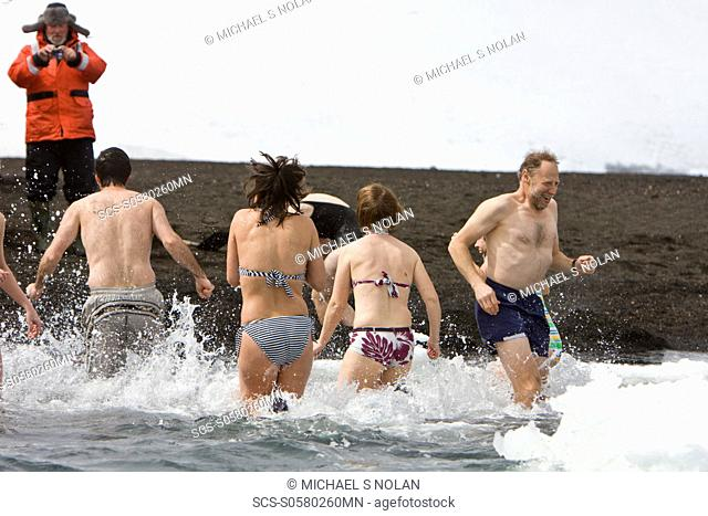 Lindblad Expeditions guests doing the 'polar Plunge' in Port Foster near Whalers Bay inside the caldera on Deception Island, South Shetland Island Group