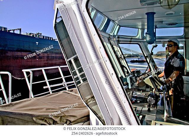 Tugboat operation at Aviles harbor, Asturias, Spain
