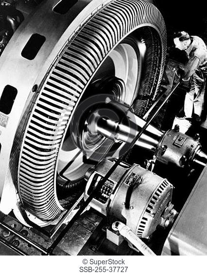 High angle view of a man working on an alternating-current generator