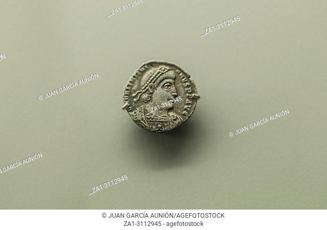 Merida, Spain - August 25th, 2018: Roman Imperial coins of Emperor Valentinian I. National Museum of Roman Art in Merida, Spain