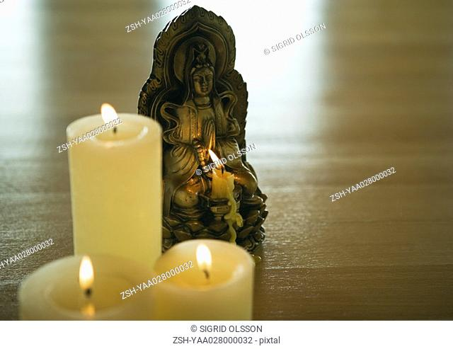 Candles and buddha statuette