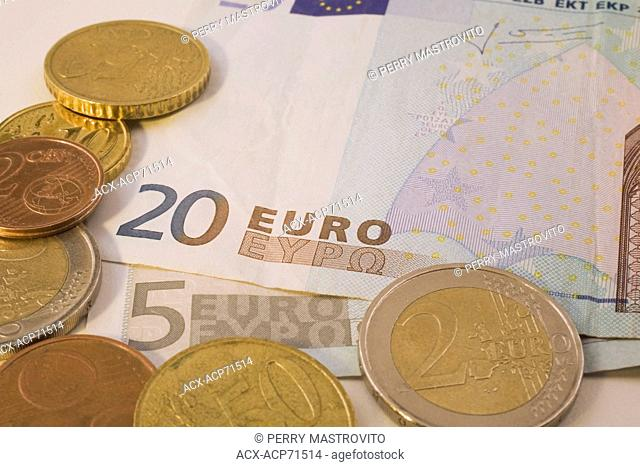 Close-up of 20 and 5 Euro Currency Bank Notes and Coins, Studio Composition