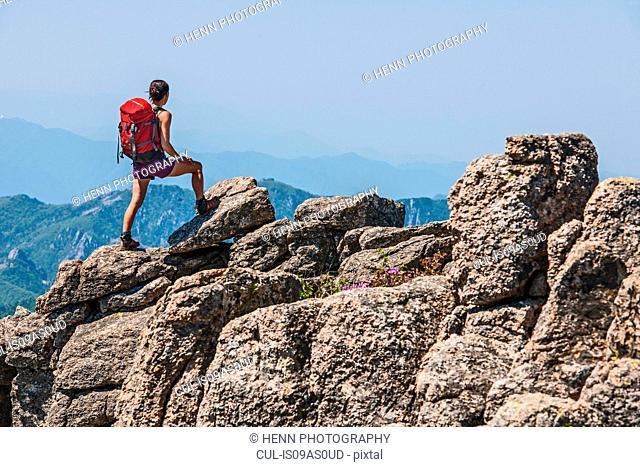 Female hiker looking out from ridge on way to Daecheongbong peak, Seoraksan National Park in South Korea