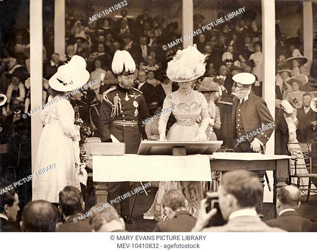 King George V and Queen Mary laying the foundation stone for the National Library at Aberystwyth, Wales. The Prince of Wales (later Edward VIII) and Princess...