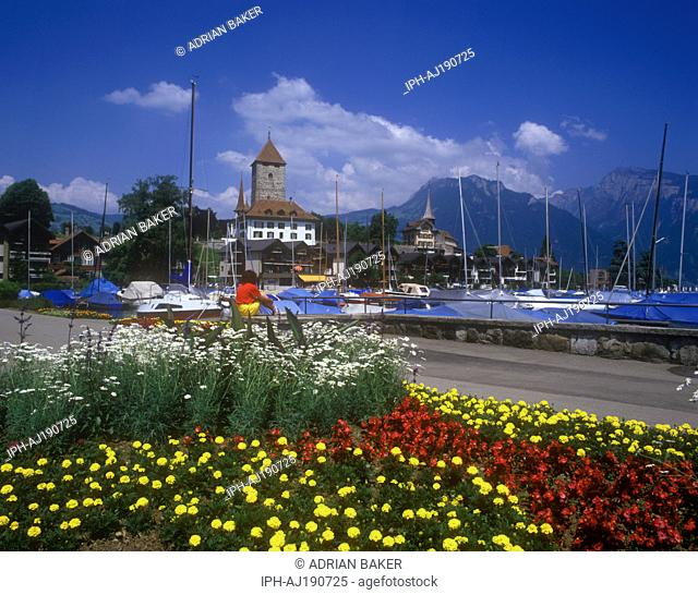 Lakeside gardens and medieval castle beside the marina in the picturesque resort of Spiez on Lake Thun