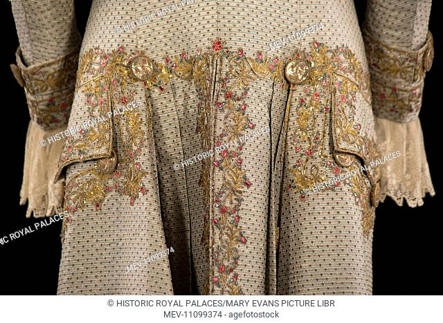 Gentleman's court coat (detail). Ivory silk brocaded with silver metallic thread and tiny ivory, pink, green and black 'rosebud' spots and alternating thin blue...
