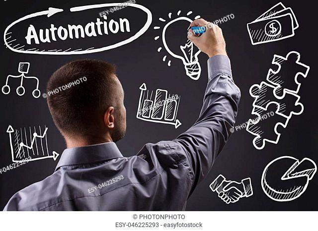 Technology, internet, business and marketing. Young business man writing word: Automation