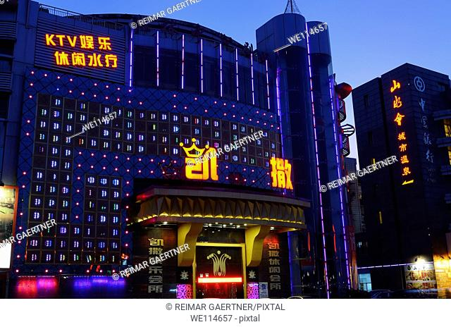 Guilin Royal Number One KTV and Bank of China at twilight in Guilin