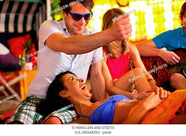 Group of friends having fun at indoor beach party