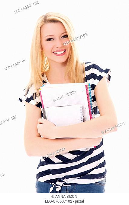 Student girl holding notebooks, Debica, Poland