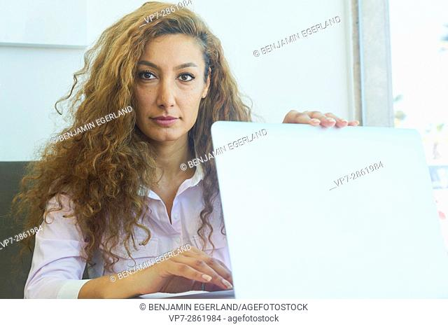 eminent mature business woman folding notebook after successfully finishing work