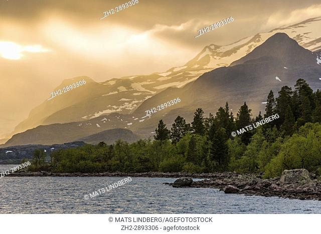 Sun shining on mountain and make it glow, snow on the mountain, Stora sjöfallets national park, Gällivare, Swedish Lapland, Sweden