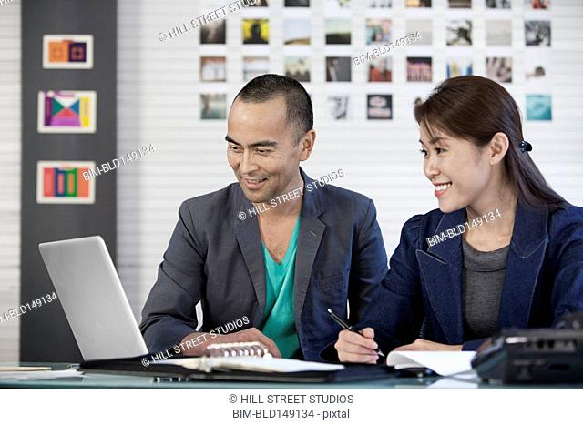 Japanese co-workers working together in office