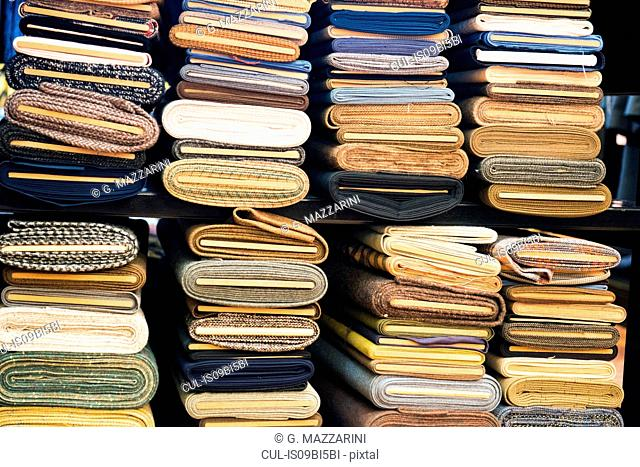 Stacks of rolled cloth in traditional tailors shop
