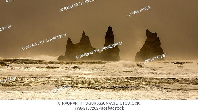 Basalt Sea Stacks and waves at Reynisfjara Beach located in Vik in Myrdal, South Coast of Iceland. Icelandic folklore states that these stacks are thought to be...