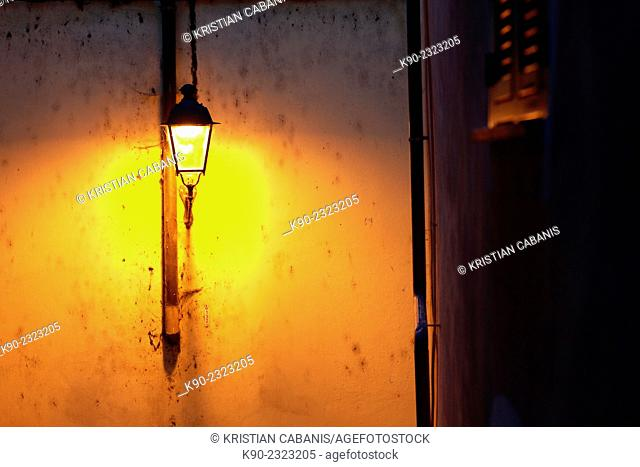 Latern in a narrow street of Dolceacqua, Liguria, Italy, Europe