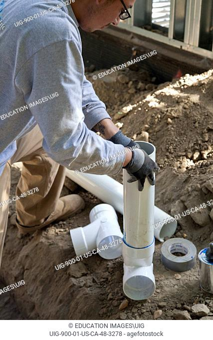 Poly Vinyl Chloride, PVC, Pipes being installed for rainwater harvesting system at new home construction, California