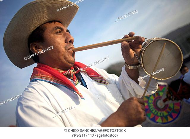 A Totonacan indigenous man plays flute and drums from Papantla, Veracruz, as part of the Dance of the Guaguas at the pilgrimage to Our Lady of Guadalupe...