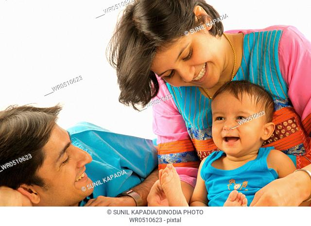 Parents with one year old baby boy laughing MR592 29-March-2008