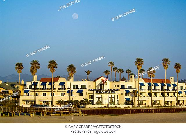 Moon rising over the Sandcastle Inn, along the shore at Pismo Beach, California
