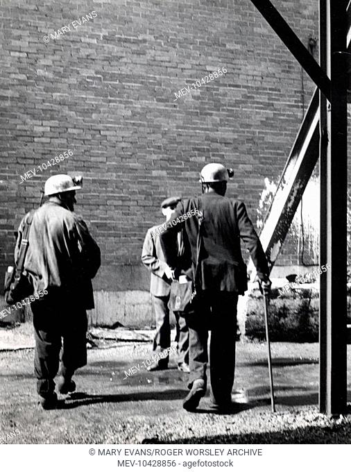 Two miners with a colliery official at a mine in South Wales