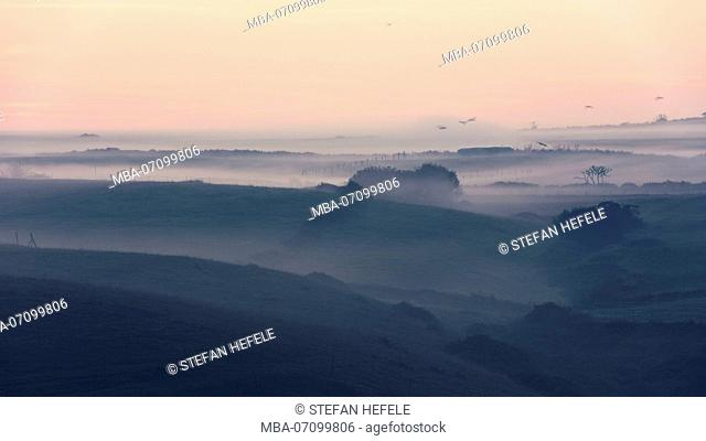 Early morning mist over the backcountry of the coast near Santander, Cantabria, Spain