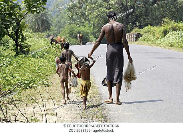 Rear view of a fisherman along with his children