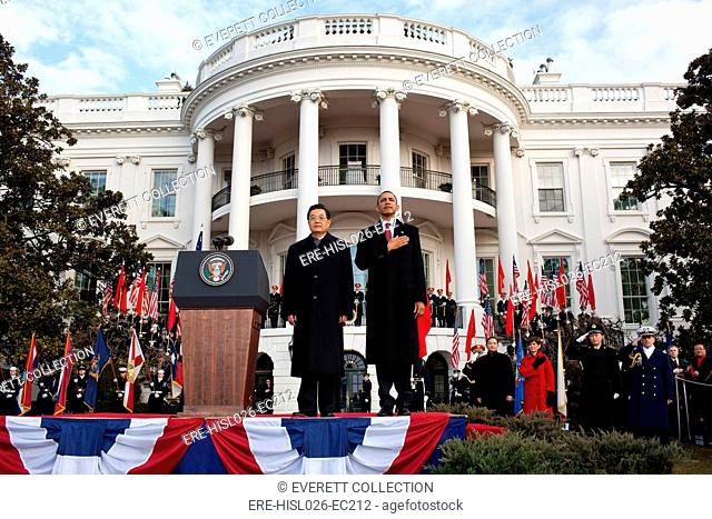 Welcoming ceremony for Chinese President Hu Jintao on the South Lawn of the White House. President Obama salutes during the US national anthem. Jan