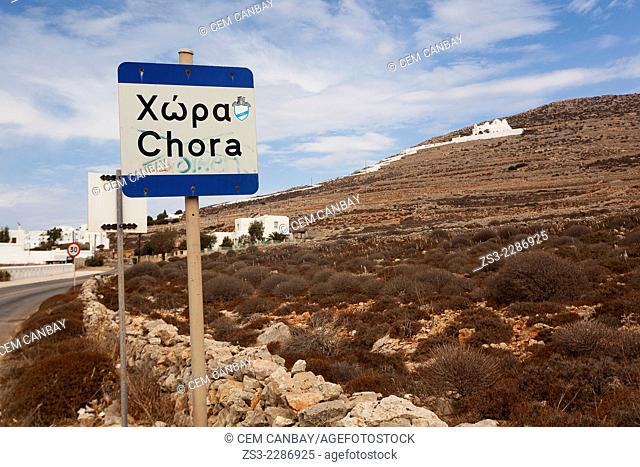 Road leading up to the old town Chora and to the Panagia Kimissis with a sign in the foreground, Folegandros, Cyclades Islands, Greek Islands, Greece, Europe