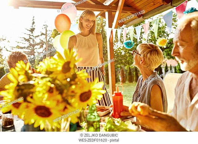Happy couple with parents having a garden party