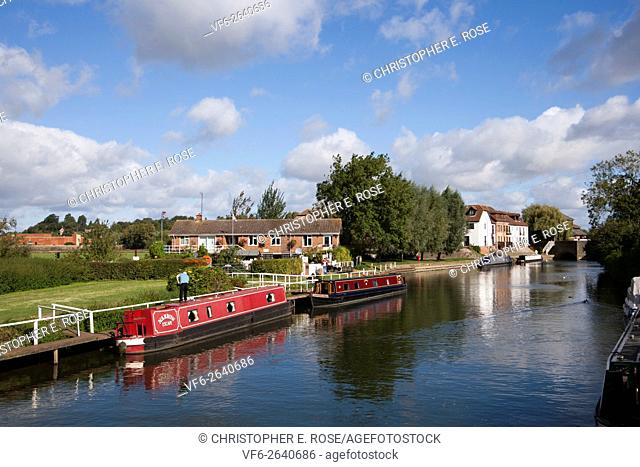 Colourful canal boats at moorings along the Avon Navigation near the centre of Tewkesbury, Gloucestershire, UK
