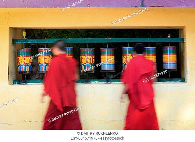 Buddhist monks rotating prayer wheels in McLeod Ganj