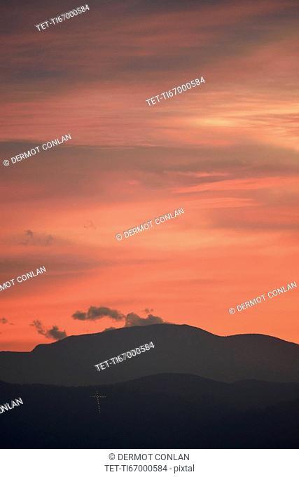 USA, Colorado, Denver, Colorful sky over mountain range