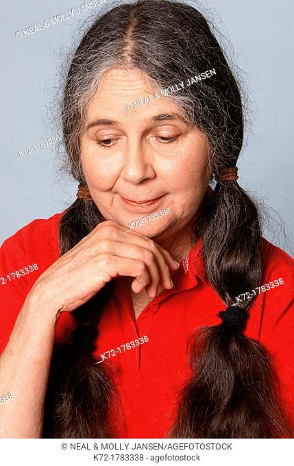 Older woman looking down with pity and caring on her face