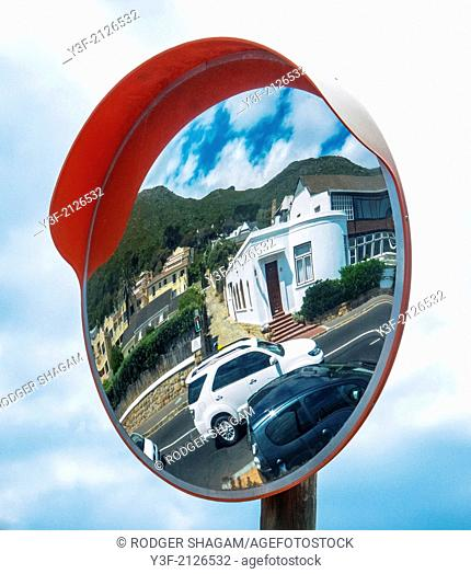 "A pole-mounted mirror at an obscured intersection, allows drivers to see ""around the corner"""