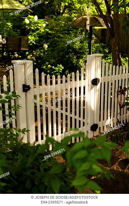 A white picket fence and gate in a garden.Georgia USA
