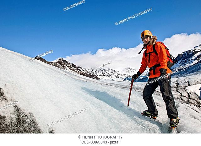 Mature female hiker on glacier, Svinafellsjokull, Vatnajokull National Park, Iceland